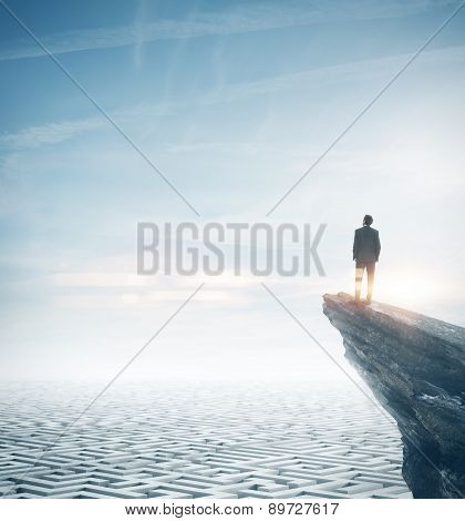 Businessman standing on a rock and looking at the sky. 3d render
