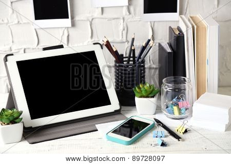 Stylish workplace with digital tablet at home or studio