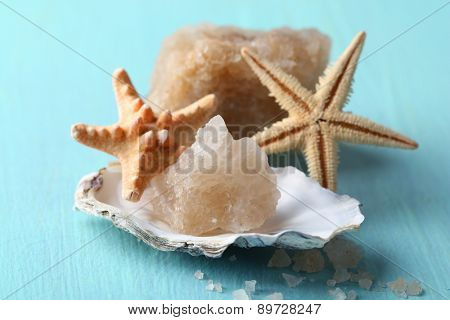 Crust of sea salt from Dead Sea coast, on color wooden background