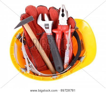 Construction tools in helmet isolated on white