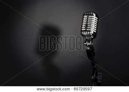 Retro silver microphone on gray background