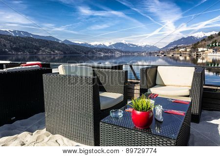 Lakeside bar with a mountain view
