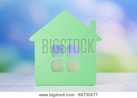 Toy house on natural background