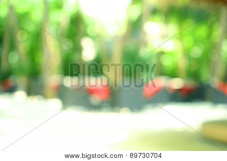 Blurred background of restaurant platform with seats in resort