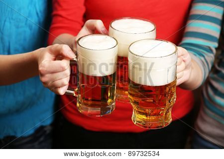 Beer in female hands, closeup
