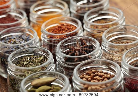 Rows of jars with various spices