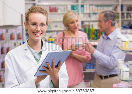 Pharmacist using tablet pc at the pharmacy
