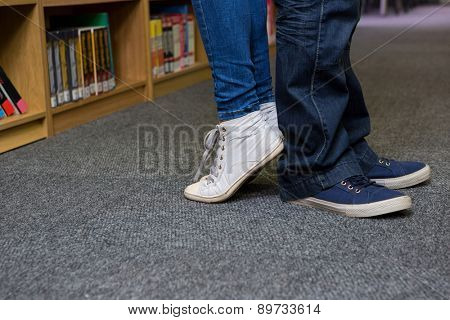 Students standing back-to-back in the library at the university