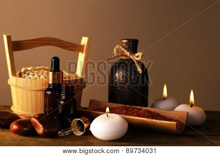 Spa still life on wooden table on brown background