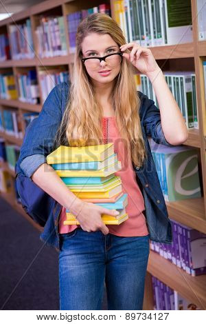 Pretty student in the library at the university