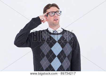 Geeky hipster thinking with finger on temple on white background