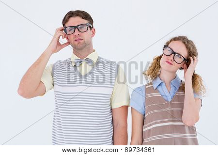 Geeky hipster couple thinking with hand on temple on white background
