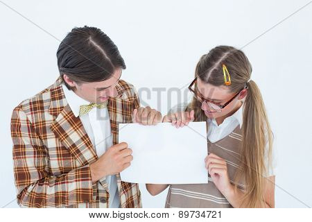 Geeky hipsters holding a poster on white background