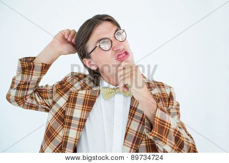 Geeky hipster scratching his head on white background