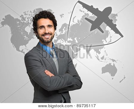 Portrait of a smiling businessman in front of a world map