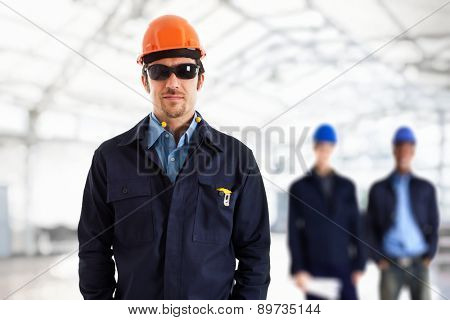 Engineer in front of his team. Bright background