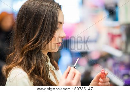 Portrait of a woman trying a product in a beauty shop
