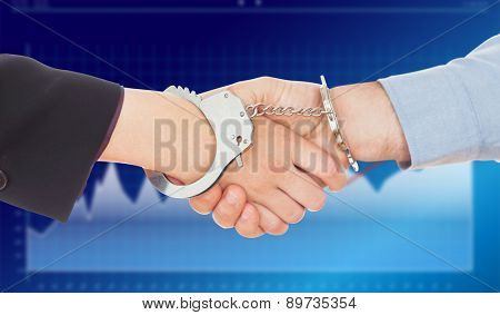 Business people in handcuffs shaking hands against business interface with graphs and data