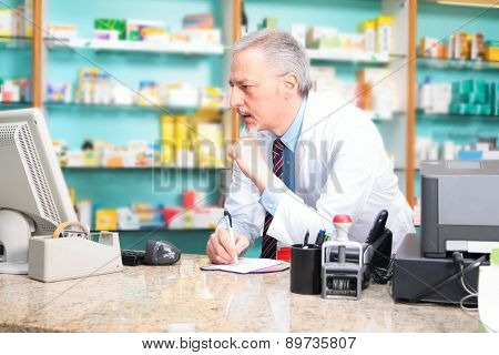 Portrait of a pharmacist using a computer