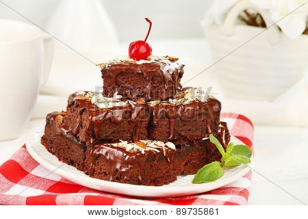 Delicious chocolate cakes on plate on table close-up