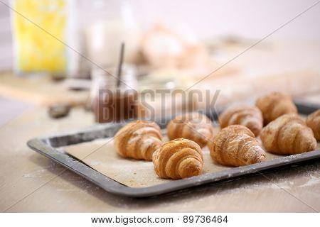 Baking croissant cookies.