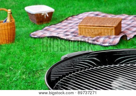 Bbq Grill,picnic Basket With  Wine, Blanket  On The Lawn