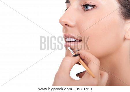Woman Applying Lip Gloss With Brush