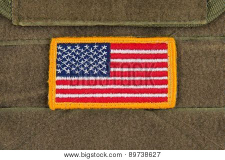Rounded American flag patch on U.S. military combat uniform,Marine Coyote Color.