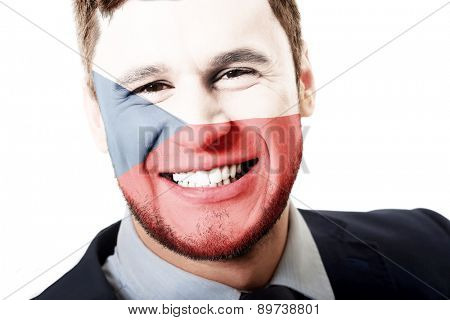 Happy man with Czech Republic flag painted on face.