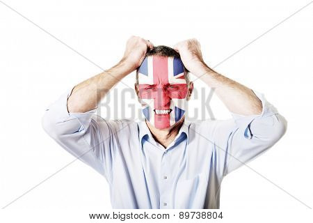 Mature man with Great Britain flag painted on face.
