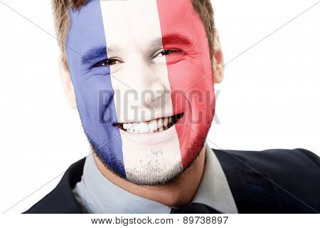 Happy man with France flag painted on face.