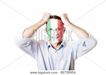 Mature man with Italy flag painted on face.