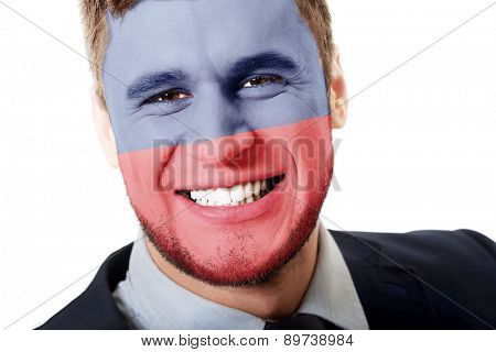 Happy man with Lichtenstein flag painted on face.