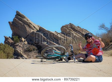 Fallen bicycle rider