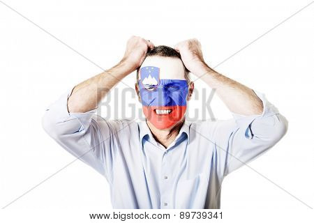 Mature man with Slovenia flag painted on face.