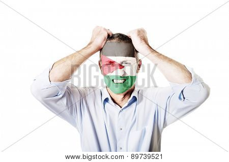 Mature man with Palestine flag painted on face.