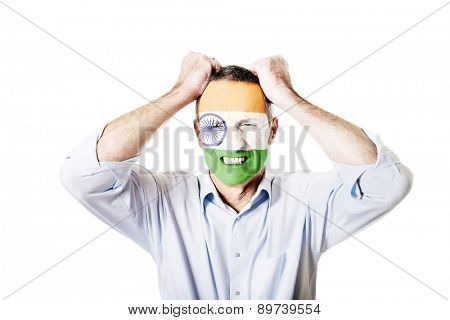 Mature man with Indie flag painted on face.