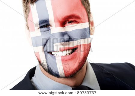 Happy man with Norway flag painted on face.