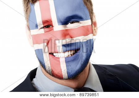 Happy man with Iceland flag painted on face.