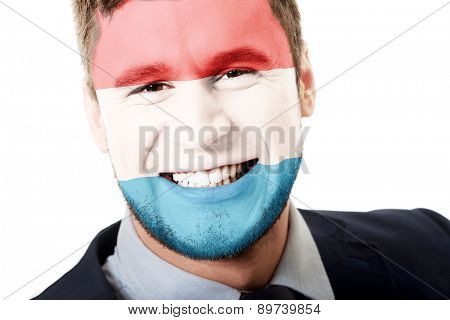 Happy man with Luksemburg flag painted on face.