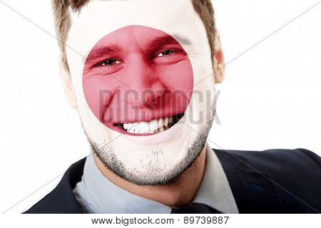 Happy man with Japan flag painted on face.