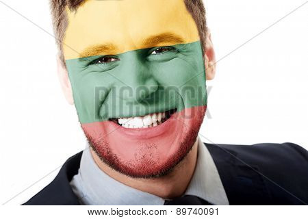 Happy man with Lithuania flag painted on face.