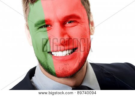 Happy man with Portugal flag painted on face.