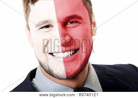 Happy man with Malta flag painted on face.