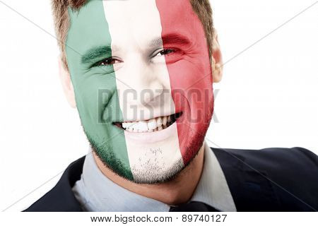 Happy man with Mexico flag painted on face.