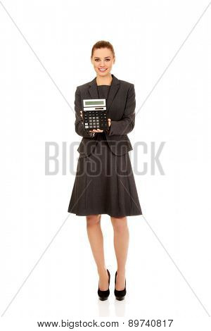 Happy businesswoman holding a calculator.