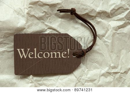 Brown Label With Welcome Paper Background