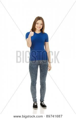 Happy female teenager showing thumbs up.