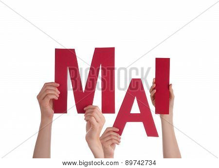 People Holding German Word Mai Means May