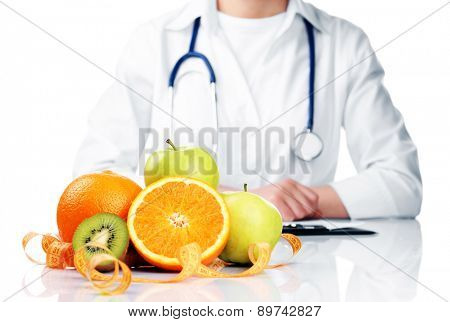 Nutritionist doctor with fruits isolated on white